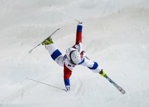 Russia's Sergey Volkov crashes during the men's freestyle moguls qualification round.
