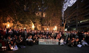 The crowd raising their candles for killed Iranian asylum seeker, Reza Berati, at the Light the Dark vigil for asylum seekers in Town Hall Square Sydney. Photograph: Siobhan Marren/Demotix/Corbis