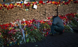 Flowers are seen placed at a barricade in Independence Square, Kiev