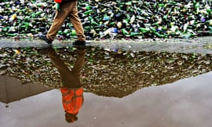 TOPSHOTS-A worker at a glass recycling f