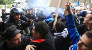 Cyprus's state electricity utility workers clash with police outside the parliament during a protest against plans to sell off government assets in Cyprus February 24, 2014.