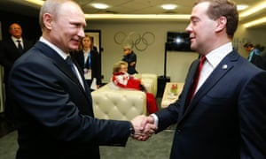 Russian President Vladimir Putin (L)  in conversation with Prime Minister Dmitry Medvedev.