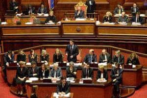 Italian Prime Minister Matteo Renzi (C) delivers a speech in the Senate in Rome, Italy, 24 February 2014. It