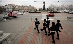 Ukrainian sailors march in the Ukrainian Black Sea port of Sevastopol in the Crimea, Ukraine, on Monday.