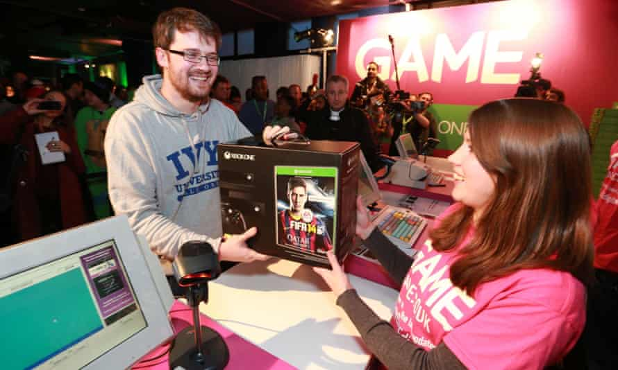 Gamer Charlie Pulbrook is the first person in the UK to pick up an Xbox One on launch night in November 2013. Microsoft has admitted the console needs better social tools to compete with Sony's rival; PlayStation 4