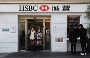 Two women a branch of HSBC in London, Britain, 24 February 2014.