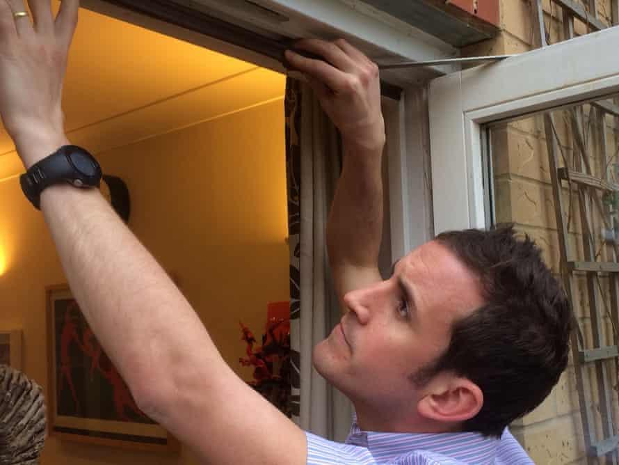 Adam Vaughan fitting draught insulation after a green deal assessment