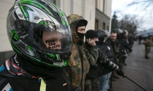 Anti-Yanukovych protesters stand guard in front of the house of parliament in Kiev on 24 February, 2014.