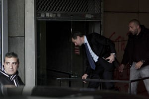 International Monetary Fund (IMF) deputy director and mission chief for Greece Poul Thomsen (C) arrives at the Finance ministry for a meeting in Athens on February 24, 2014.
