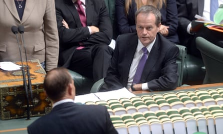 Opposition leader Bill Shorten listens to Prime Minister Tony Abbott during the House of Representatives Question time in Canberra