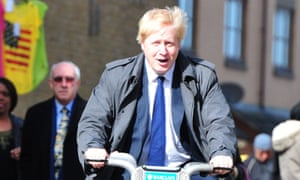 Boris Johnson, mayor of London, on a hire bike and not wearing a helmet
