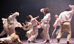 dancers in white and beige costumes