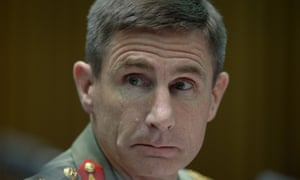 Commander of Operation Sovereign borders Lieutenant Angus Campbell reacts during Senate Estimates at Parliament House in Canberra, Tuesday, Feb. 25, 2014