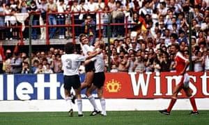 Horst Hrubesch celebrates scoring with Pierre Littbarski.