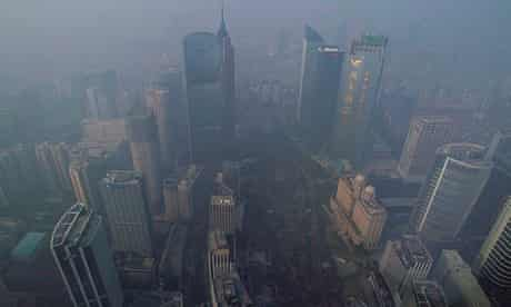 Buildings are seen through thick haze in Guangzhou