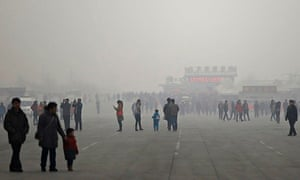 People visit the Olympic Park amid thick haze in Beijing