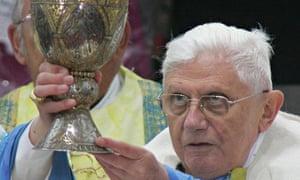 Pope Benedict XVI lifts the wine bowl