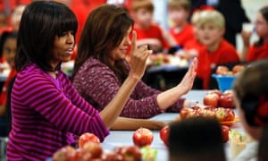 First lady Michelle Obama and Food Network chef Rachel Ray discussing lunches with students from the Eastside and Northside Elementary Schools in Clinton, Mississippi.