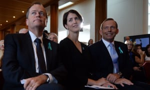 Prime Minister Tony Abbott and Opposition leader Bill Shorten attend the launch of the Ovarian Cancer Awareness Month with Ovarian Cancer Australia chair Paula Benson at Parliament House in Canberra, Wednesday, Feb. 26, 2014.