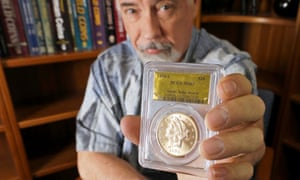 Coin grader David Hall shows a sample from the 'Saddle Ridge Hoard'