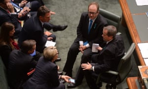 Opposition Leader Bill Shorten consults with front bench colleagues during question time in the House of Representatives at Parliament House in Canberra, Wednesday, Feb. 26, 2014.