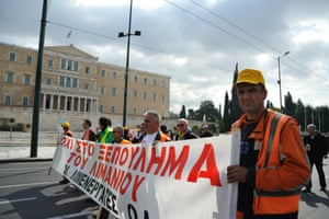 Dock workers march in front of the Greek Parliament against the privatization of ports. -- Dock workers march to the Greek Parliament voicing their anger at the planned privatization of ports.
