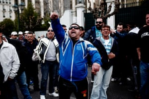 Dockworkers shout slogans during a demonstration in front of the Greek Parliament against the privatisation of Greek ports, on February 26, 2014, in Athens.