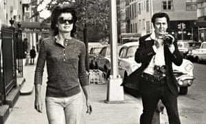 Jackie Onassis is pursued through the streets of New York by Ron Galella.