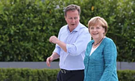 David Cameron with German chancellor Angela Merkel duringopening ceremony of the G8 Summit