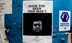 A poster with a photo of fugitive Ukrainian President Viktor Yanukovych, who fled the capital Kiev and went into hiding after months of protests against his government.