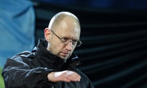 Former economy minister Arseny Yatseniuk gestures on the stage during a rally in Independence Square in Kiev, on 26 February, 2014.