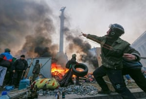 A protester uses a catapult during clashes with riot police in Kiev. According to its opponents, both internal and external, what happened in Ukraine last week was neither popular nor an insurrection.