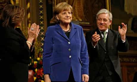 German Chancellor Angela Merkel is applauded