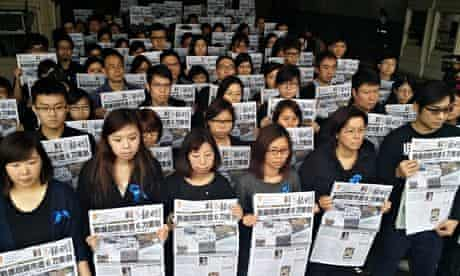 Newspaper staff wearing black in solidarity with Kevin Lau