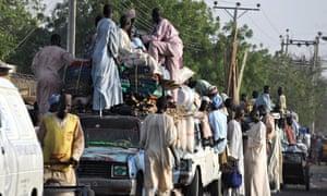Residents flee following fierce fighting between Nigerian troops and Boko Haram at Baga, Nigeria