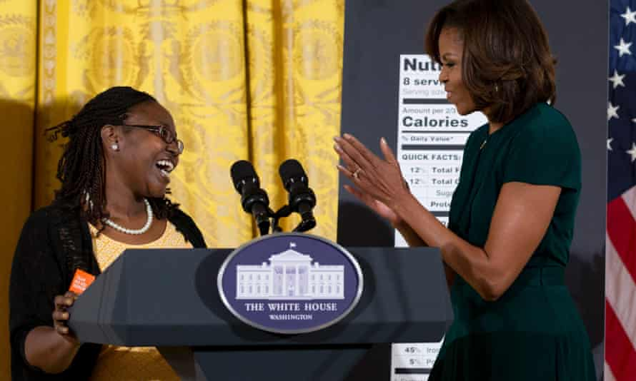 Shanese Bryant-Melton, of Washington, DC., left, smiles as he looks to first lady Michelle Obama.