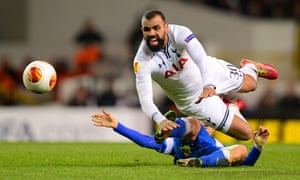Ruslan Rotan of Dnipro Dnipropetrovsk tackles Sandro of Tottenham Hotspur during the UEFA Europa League second leg match at White Hart Lane.