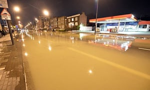 Flood water from a burst main in Clapham Road in Kennington, south London.