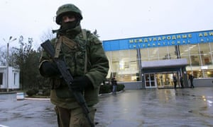 A gunman outside Simferopol airport in Crimea