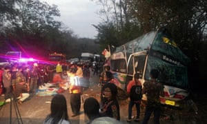 Scene of a bus crash in Thailand that killed 15 people, including 13 children.