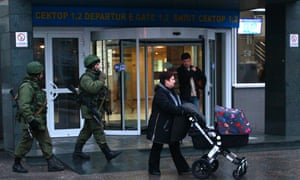 Armed men patrol at the airport in Simferopol, Crimea on 28 February, 2014.