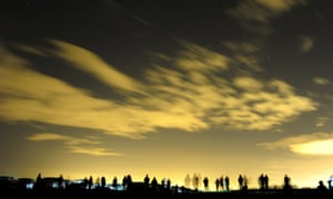 Crowds gather to see the northern lights at St. Mary's Lighthouse and Visitor Centre, Whitley Bay.