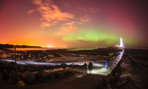 The northern lights dance over St. Mary's Lighthouse in Whitely Bay.