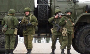 Unidentified soldiers block a road to Ukrainian military airport Belbek not far from Sevastopol on 28 February, 2014.