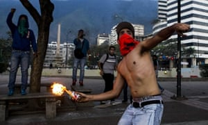A demonstrator throws an incendiary device during clashes with Venezuelan National Bolivarian Guard (GNB) during a protest against president Nicolas Maduro in Caracas, Venezuela. The Venezuelan government accuses the opposition of attempting a coup d'etat to topple President Nicolas Maduro, who narrowly won election last year as the hand-picked successor to left-wing populist Hugo Chavez, who died in office March 2013.
