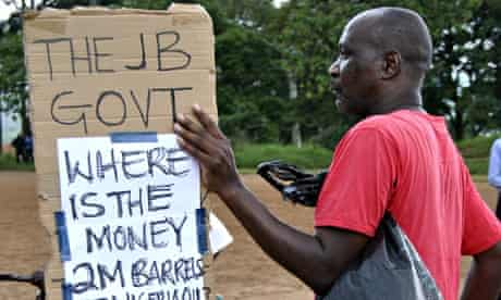 A Malawian activist takes part in a protest against corruption