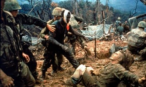 Wounded marine gunnery sargeant Jeremiah Purdie (C) with stricken comrades in sth Vietnam 1966