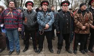 Pro-Russian Cossacks rally outside the Crimean parliament building in Simferopol.