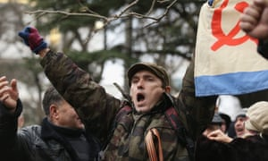 Pro-Russian supporters rally outside the Crimean parliament building in Simferopol.