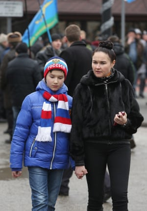 A young pro-Russian girl shows patriotic colours while attending a rally in Simferopol.